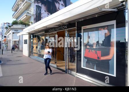 Woman Leaving Luxury or Up-Market Louis Vuitton Store on BBoulevard de la Croisette, Cannes, French Riviera, France