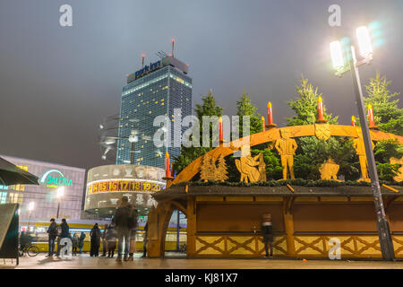 View over Alexanderplatz in Berlin at night with the World time clock (Weltzeituhr) and the Park Inn Hotel and the - Stock Photo