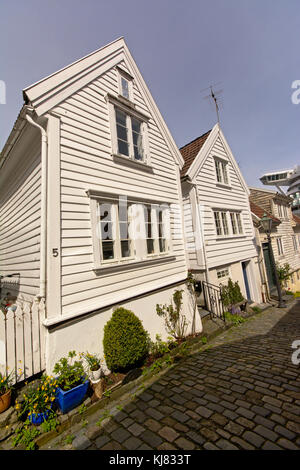 Traditional wooden houses along a cobblestone street in the old town of Stavanger, Norway - Stock Photo