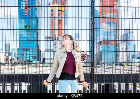 Closeup of young hipster millennial woman looking at Hudson Yards in NYC New York City Manhattan downtown on high - Stock Photo