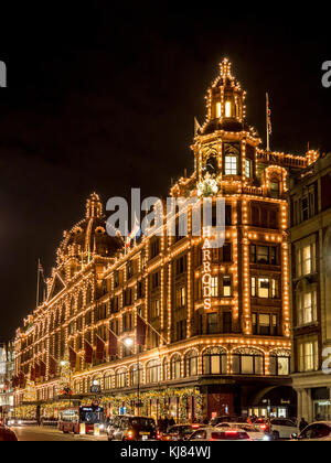 Harrods luxury department store illuminated at night, London, UK - Stock Photo