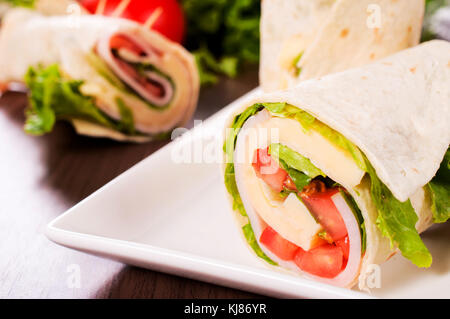 Selective focus on the front sandwich wrap - Stock Photo