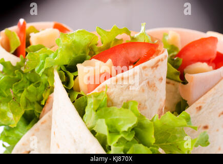 Selective focus on the front tortilla with turkey and vegetables - Stock Photo