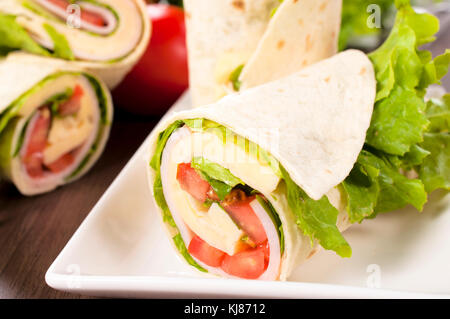 Selective focus on the front tortilla wrap - Stock Photo