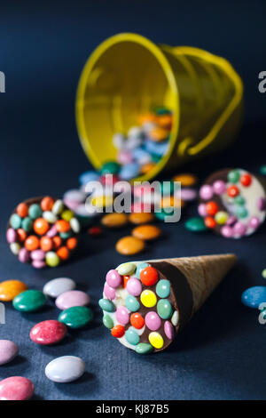 Sweet chocolate ice creams with colorful bonbons,selective focus - Stock Photo