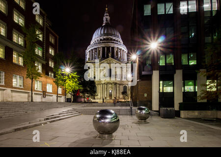 View towards Sir Christopher Wren's iconic famous landmark St Paul's cathedral from south bank at night with metal - Stock Photo