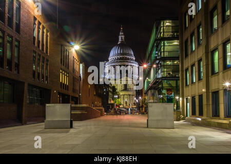 View towards Sir Christopher Wren's iconic famous landmark St Paul's cathedral from south back at night - Stock Photo