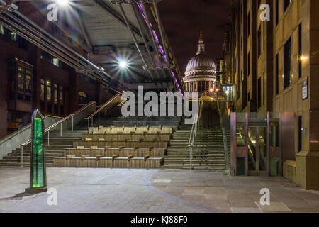 View towards Sir Christopher Wren's iconic famous landmark St Paul's cathedral from south bank at night Sleek suspension - Stock Photo