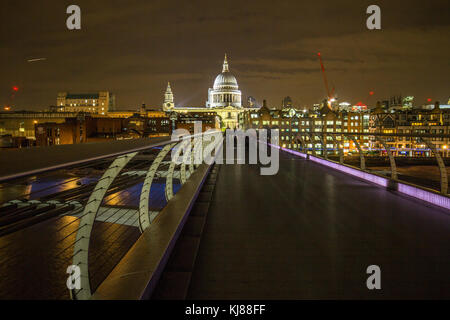 Sir Norman Foster's Wobbly Millennium Pedestrian Bridge from Southbank to Sir Christopher Wren's iconic famous landmark - Stock Photo