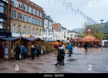 Cardiff, Wales, United Kingdom - November 23, 2016: Locals and tourists shopping and visiting the Christmas Market - Stock Photo