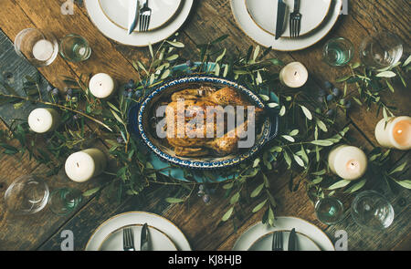 Holiday table setting for party, gathering or celebration roast chicken - Stock Photo
