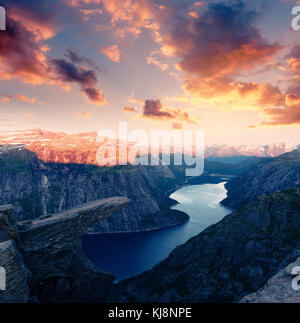 Breathtaking view of Trolltunga rock - Stock Photo