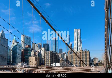 Lower Manhattan skyline seen from the Brooklyn Bridge - Stock Photo