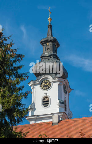 Church spire with clock, Catholic monastery church Altomünster, built in 1763 by Michael Fischer, Altomünster, Bavaria - Stock Photo