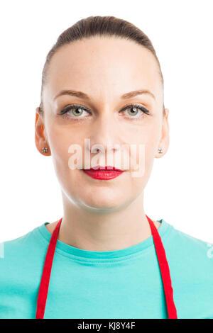 Portrait of female waiter or supermarket employee wearing red apron isolated on studio white background - Stock Photo