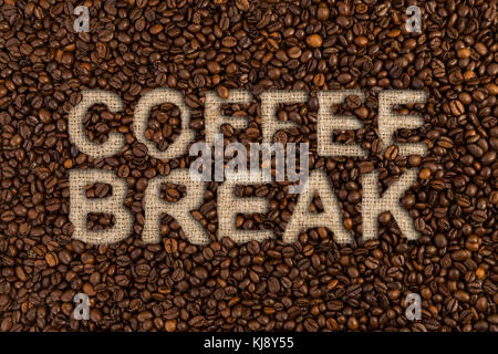 Coffee break concept written on beans and jute canvas - Stock Photo