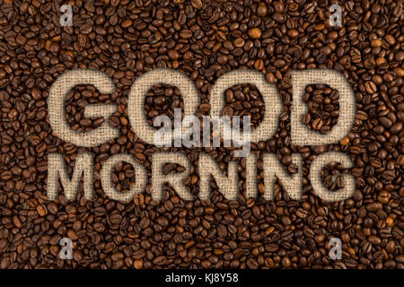 Good morning concept written on coffee beans and jute canvas fabric sack - Stock Photo