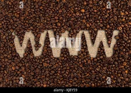 Order online coffee beans concept with www text written on jute canvas - Stock Photo