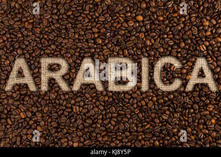 Arabic concept written on coffee beans and jute canvas fabric - Stock Photo
