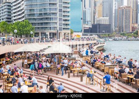 People enjoying food and drink at the Opera Bar at circular quay in Sydney,Australia