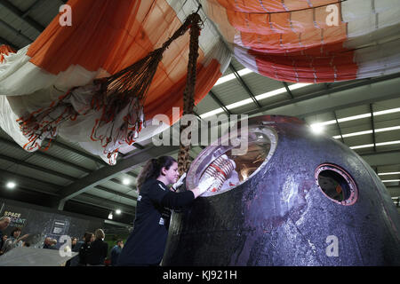 Claire Madley from the National Railway Museum Shildon in County Durham, inspects the Soyuz TMA-19M spacecraft which - Stock Photo
