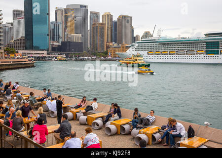 Circular quay, people at the Opera bar with circular quay and cruise liner in the background,Sydney