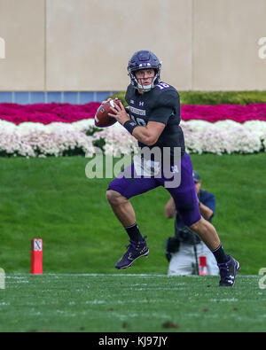 Saturday October 7th - Northwestern Wildcats quarterback Clayton Thorson (18) rolls out to the right while preparing - Stock Photo