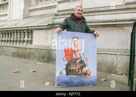 London UK. 22nd November 2017. Political satirist and artist Kaya Mar stands outside Downing Street on Budget Day - Stock Photo