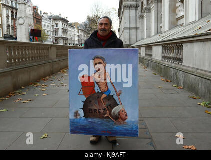 London, UK. 22nd Nov, 2017. Artist Kaya Mar with one of his paintings depicting Chancellor of the Exchequer Philip - Stock Photo