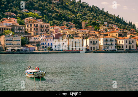 view of the traditional village of Githio with a fishing boat in foreground. Peloponnese Greece - Stock Photo