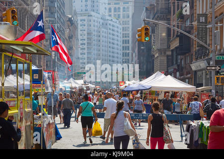 Union Square market with people in a sunny day in New York. The market is held four days each week.