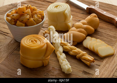Different traditional smoked and unsmoked Slovakian cheeses on a wooden board - Stock Photo