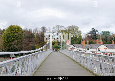 The Queen's Park Suspension Bridge crossing the River Dee in the historic city of Chester, UK and linking The Groves - Stock Photo