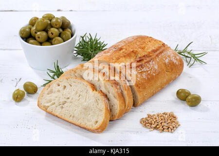 Ciabatta bread with olives food on wooden board wood - Stock Photo