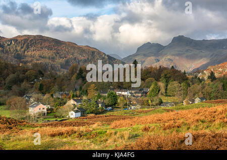 View over Elterwater Village towards the Langdale Pikes, Lake District England UK - Stock Photo