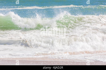 waves rolling in on an east hampton beach in east hampton, ny - Stock Photo