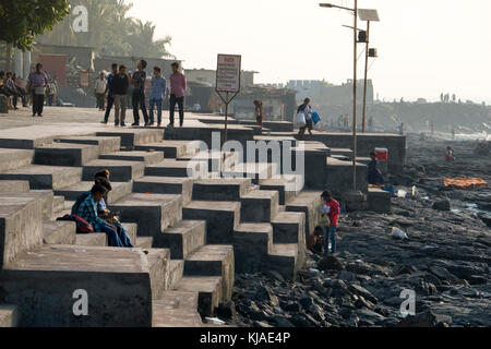 People walking along Bandstand Promenade in Bandra, Mumbai - Stock Photo