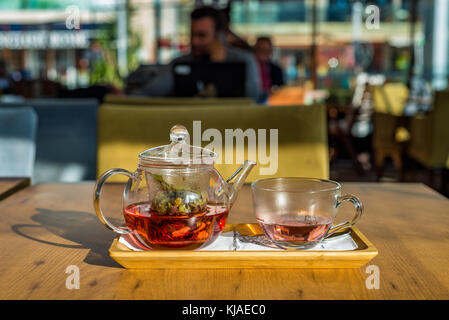 Herbal tea with echinacea and rose buds - Stock Photo