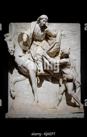 st martin sharing his cloak with beggar, palazzo strozzi, florence, italy - Stock Photo