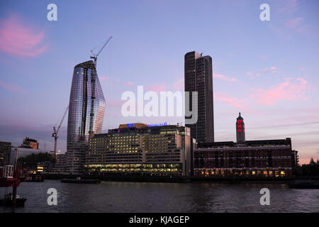 Sea Container House building and OXO in London with river Thames in foreground at twilight. - Stock Photo