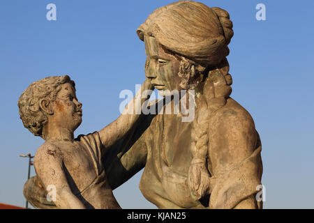Figure of woman with child at the base of Fountain of the Mothers of Macedonia at Karpos Rebellion Square in Skopje, - Stock Photo
