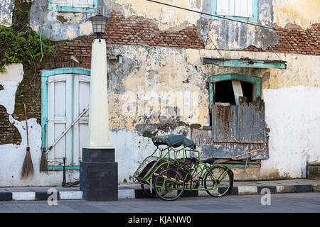 Cycle rickshaw / becak in the old town Oudstad of Semarang, Central Java, Indonesia - Stock Photo