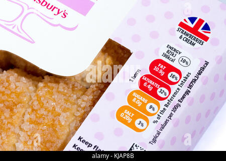 Traffic light rating system nutritional information label on a box of Sainsbury's strawberries & cream horns, United - Stock Photo
