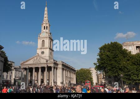 Trafalgar Square , London-September 6,2017: Tourists walking on Trafalgar Square, on background St. Martin in the - Stock Photo