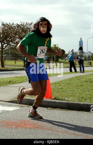 CAMP KINSER, OKINAWA, Japan- Cpl. Natanael Zunigacisneros runs during the 28th Annual Kinser Half Marathon Nov. - Stock Photo