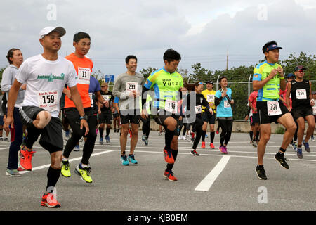 CAMP KINSER, OKINAWA, Japan- Runners participate in warm up exercises before the 28th Annual Kinser Half Marathon - Stock Photo