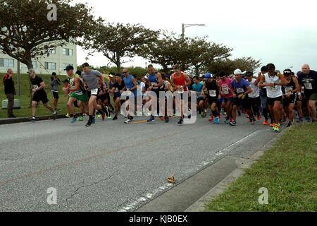 CAMP KINSER, OKINAWA, Japan- Runners take off at the start of the 28th Annual Kinser Half Marathon Nov. 19 aboard - Stock Photo