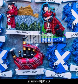 Tourist fridge magnets with Scottish motifs for sale in tourist souvenir shop in Edinburgh, Scotland, United Kingdom. - Stock Photo