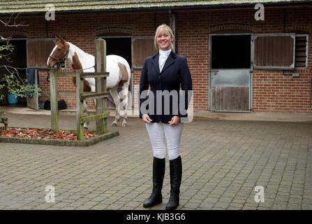 Smartly dressed horse rider wearing a dark blue riding jacket, November 2017 - Stock Photo