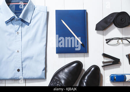 Flat lay fashion set of businessman accessories, top view on white wooden background - Stock Photo
